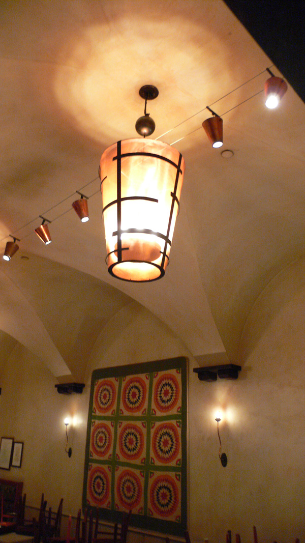 Finished light fixture, hanging in the main dining room at Gramercy Tavern