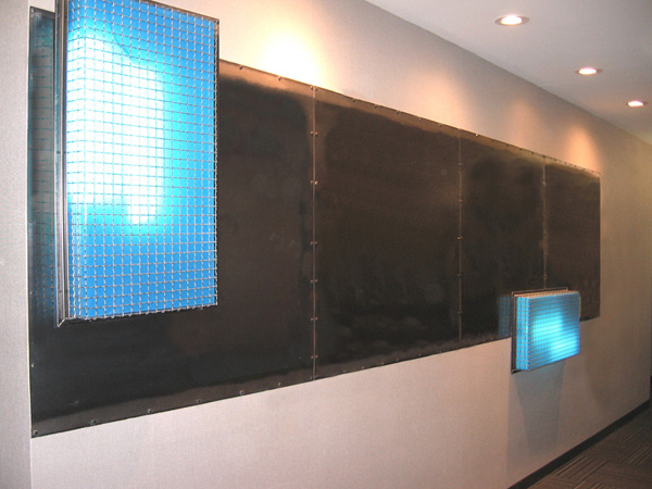 I designed several wall panels and light boxes for the dorm, which were fitted on every floor of the building