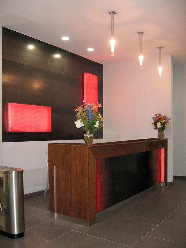 View of the wall panels and light boxes behind the lobby reception desk