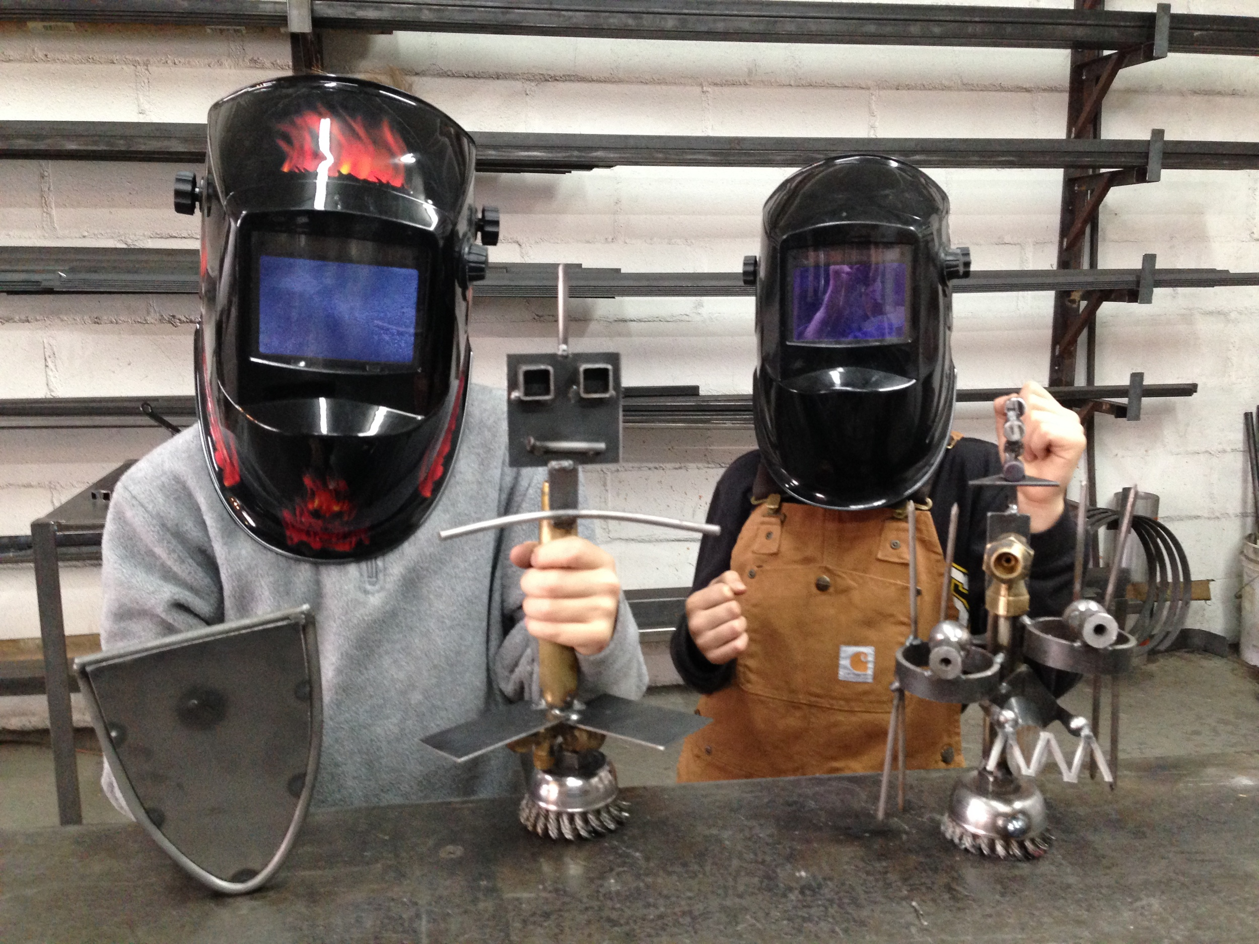Silas and Jakob with welding helmets