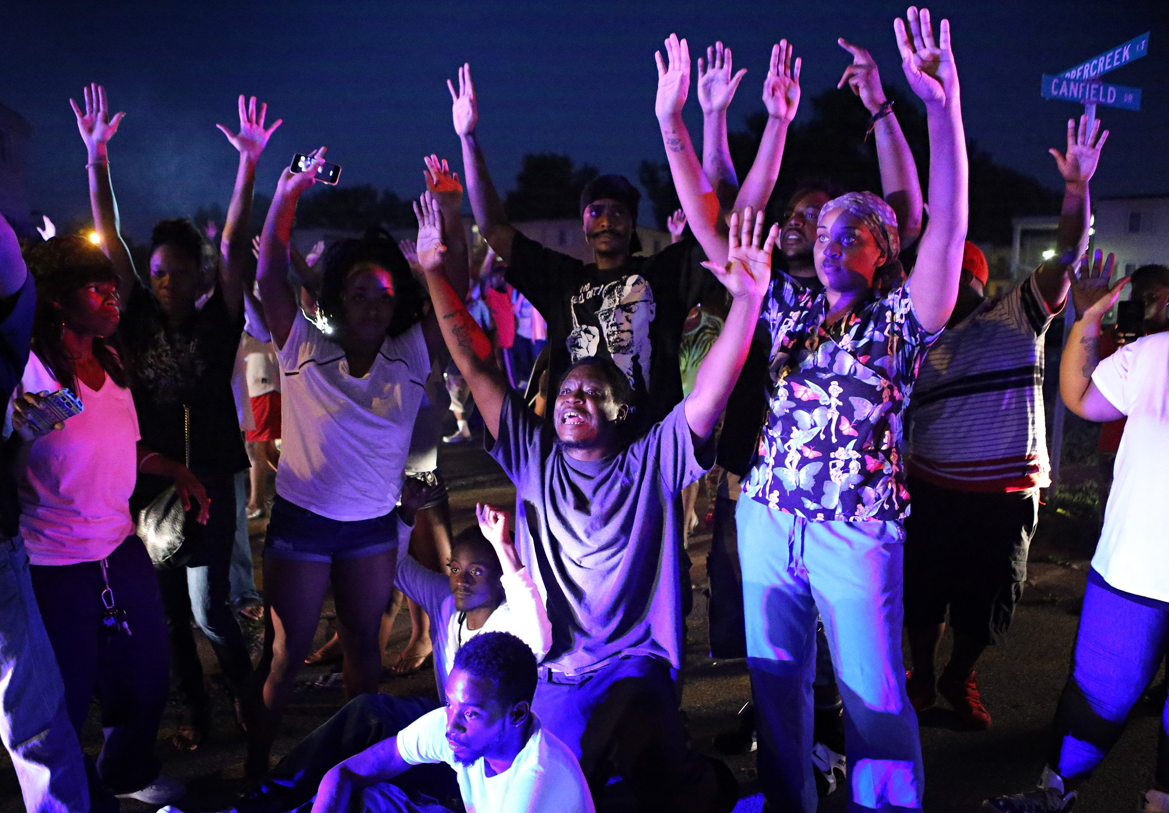 """""""Don't shoot us"""" cries out the crowd as they confront police officers arriving to break up a crowd on Canfield Dr. in Ferguson on Saturday, Aug. 9, 2014. Earlier in the day police had shot and killed an 18 year-old man on the street and the crowd of people were upset.  Photo By David Carson, dcarson@post-dispatch.com"""