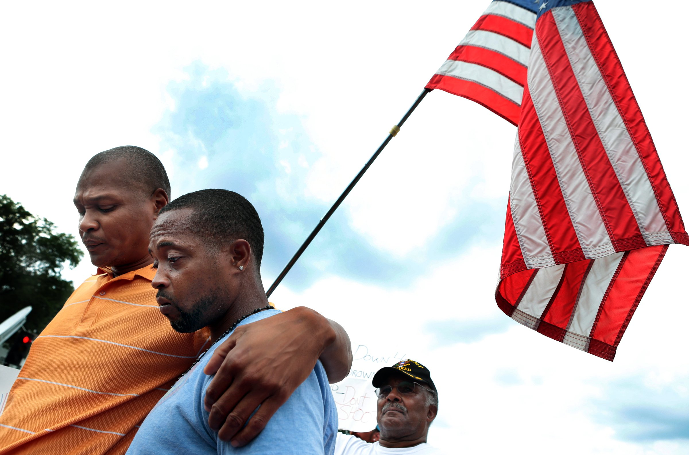 Louis Head (right), stepfather of Michael Brown, and first cousin Eric Davis attend a news conference outside the Ferguson police department where family members and attorneys spoke about the information released on Friday, Aug. 15, 2014 by Police Chief Tom Jackson.  Photo by Robert Cohen, rcohen@post-dispatch.com