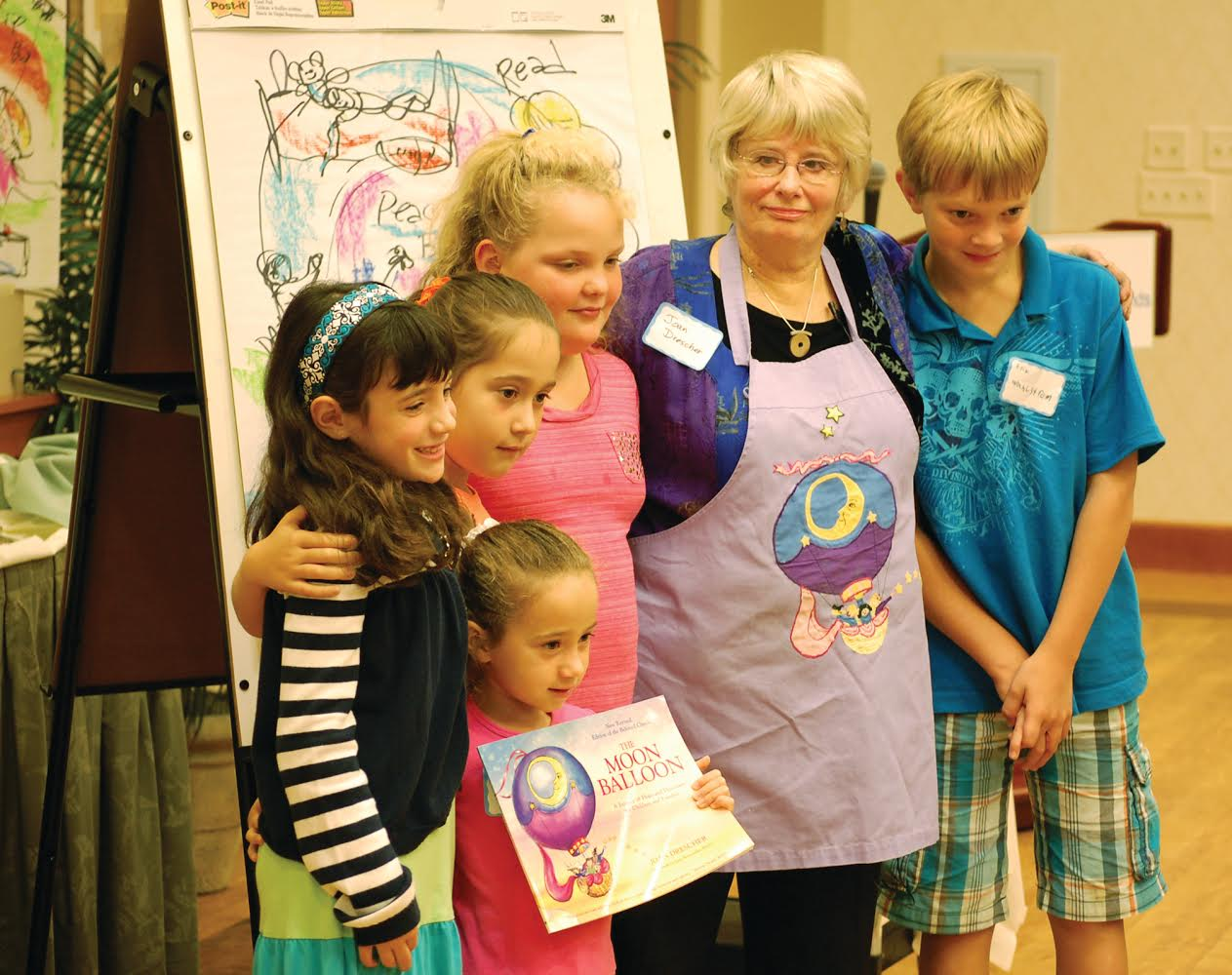 Photo of Joan Drescher and kids at a training of volunteers for Helping Children Cope Programs, a community outreach effort of The Friends of South Shore Hospital in Weymouth, MA.