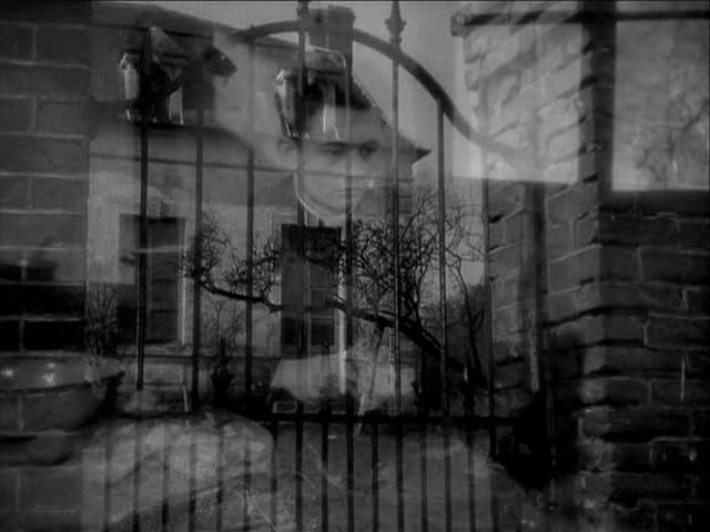 Claude Laydu (In this dissolve, symbolically imprisoned)