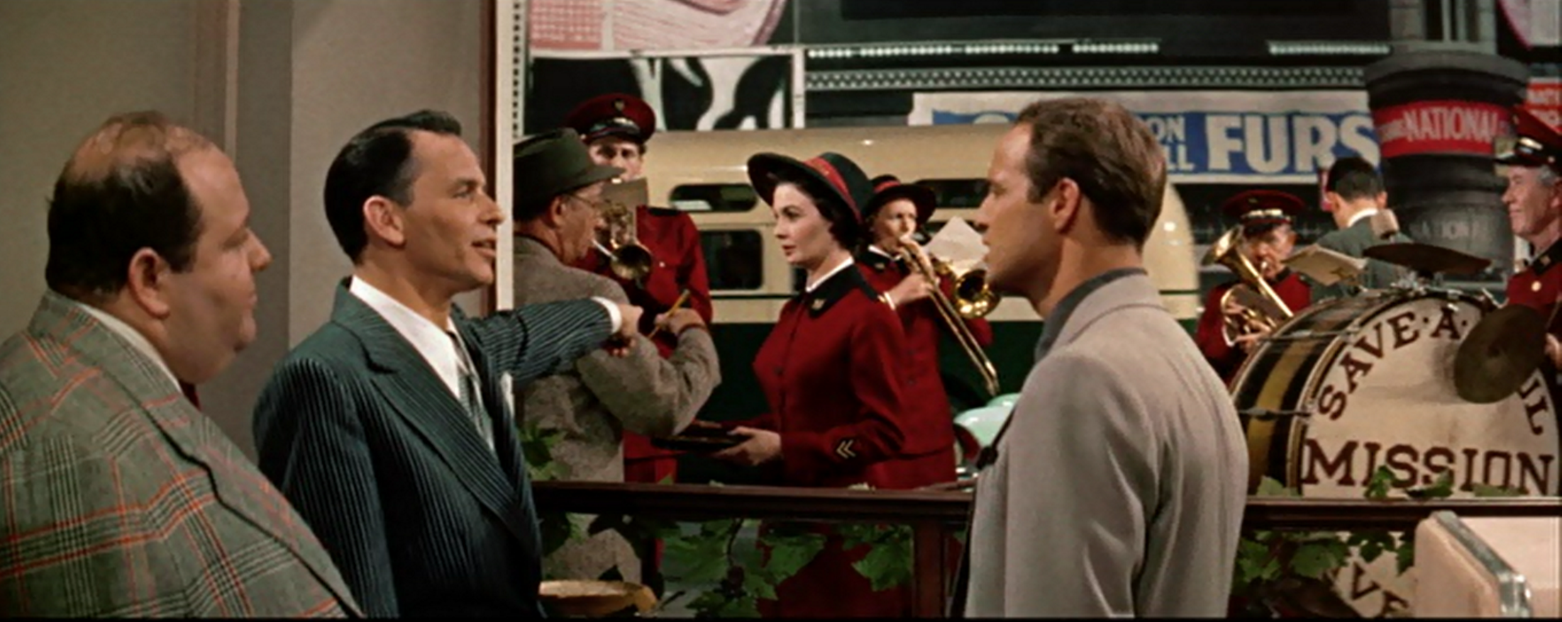(From left) Stubby Kaye, Frank Sinatra (pointing to) Jean Simmons, Marlon Brando