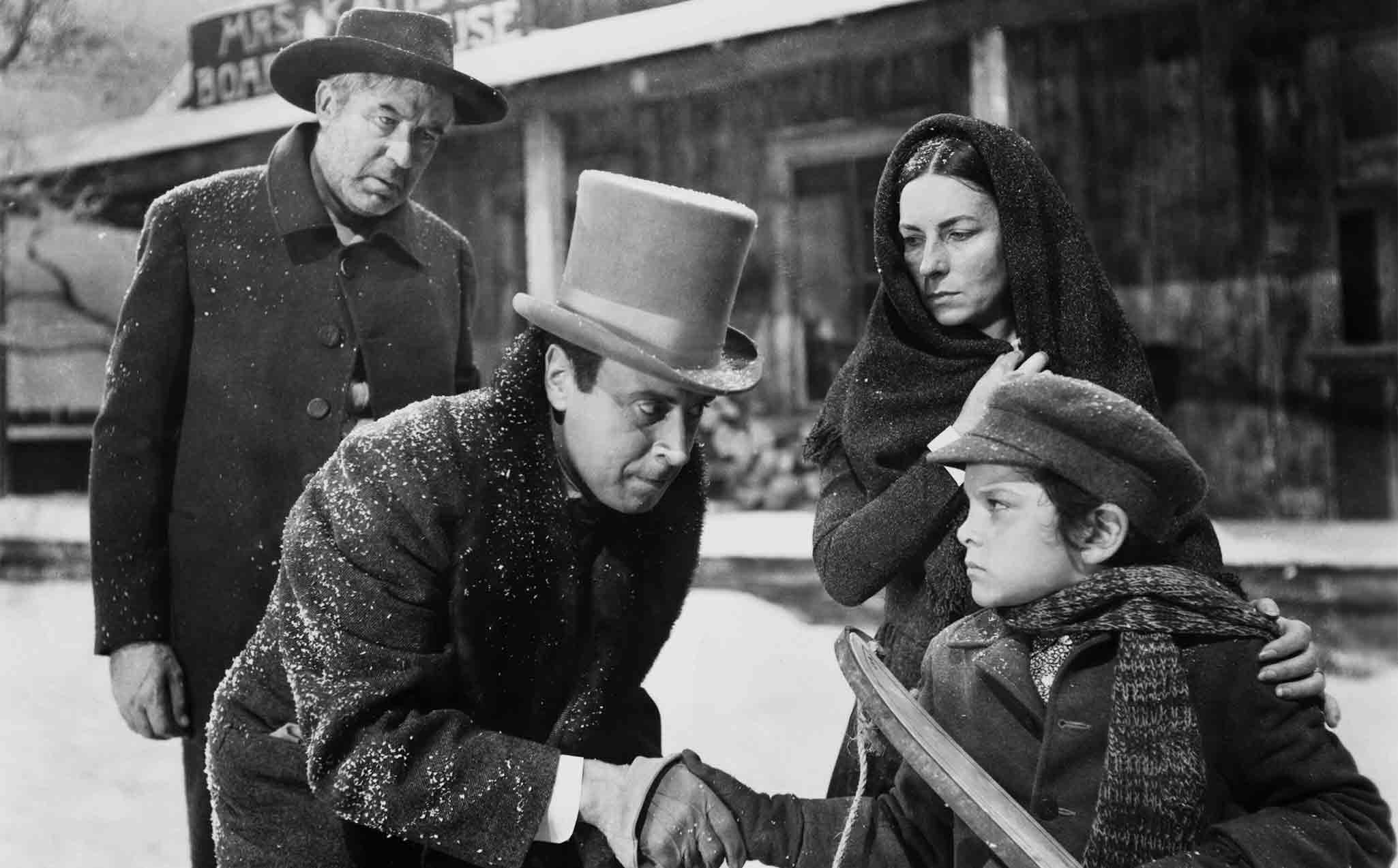 (From left) Harry Shannon, George Coulouris, Agnes Moorhead, Buddy Swan