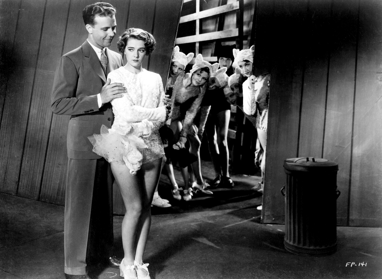 (In forefront) Dick Powell, Ruby Keeler