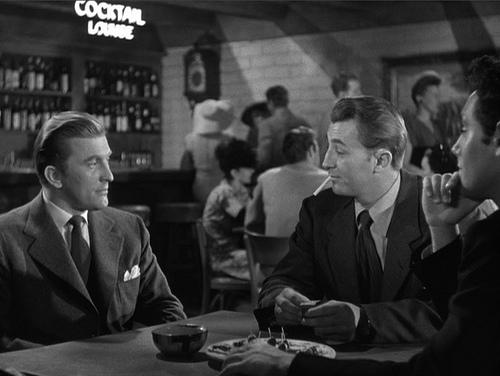 (From left in foreground) Kirk Douglas, Robert Mitchum, Paul Valentine