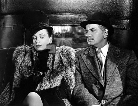 Patricia Morison as Mrs. Hilda Courtney with Frederick Worlock as Colonel Cavanaugh in  Dressed to Kill
