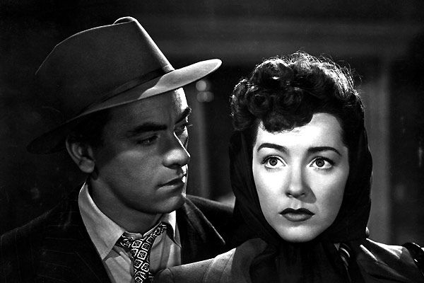 Marsha Hunt as Ann Martin with John Ireland as Fantail in  Raw Deal