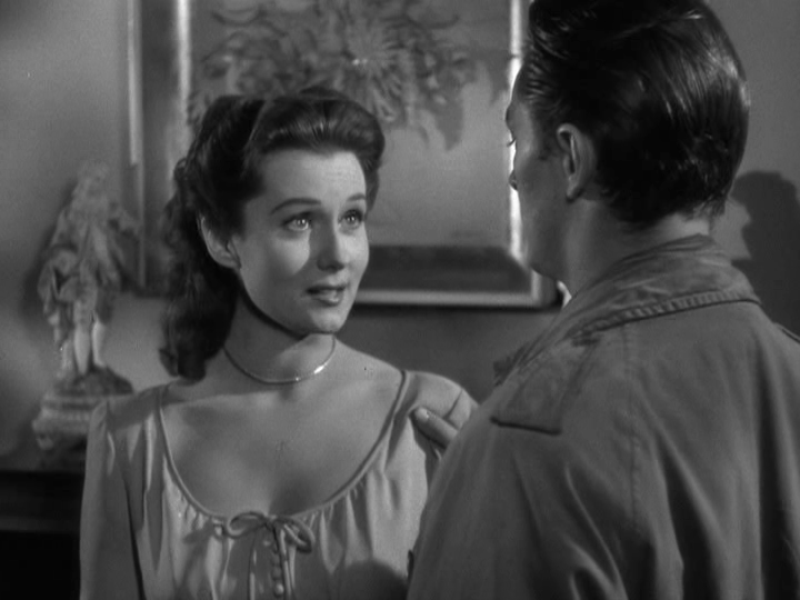 Rhonda Fleming as Meta Carson with Robert Mitchum as Jeff Bailey in  Out of the Past