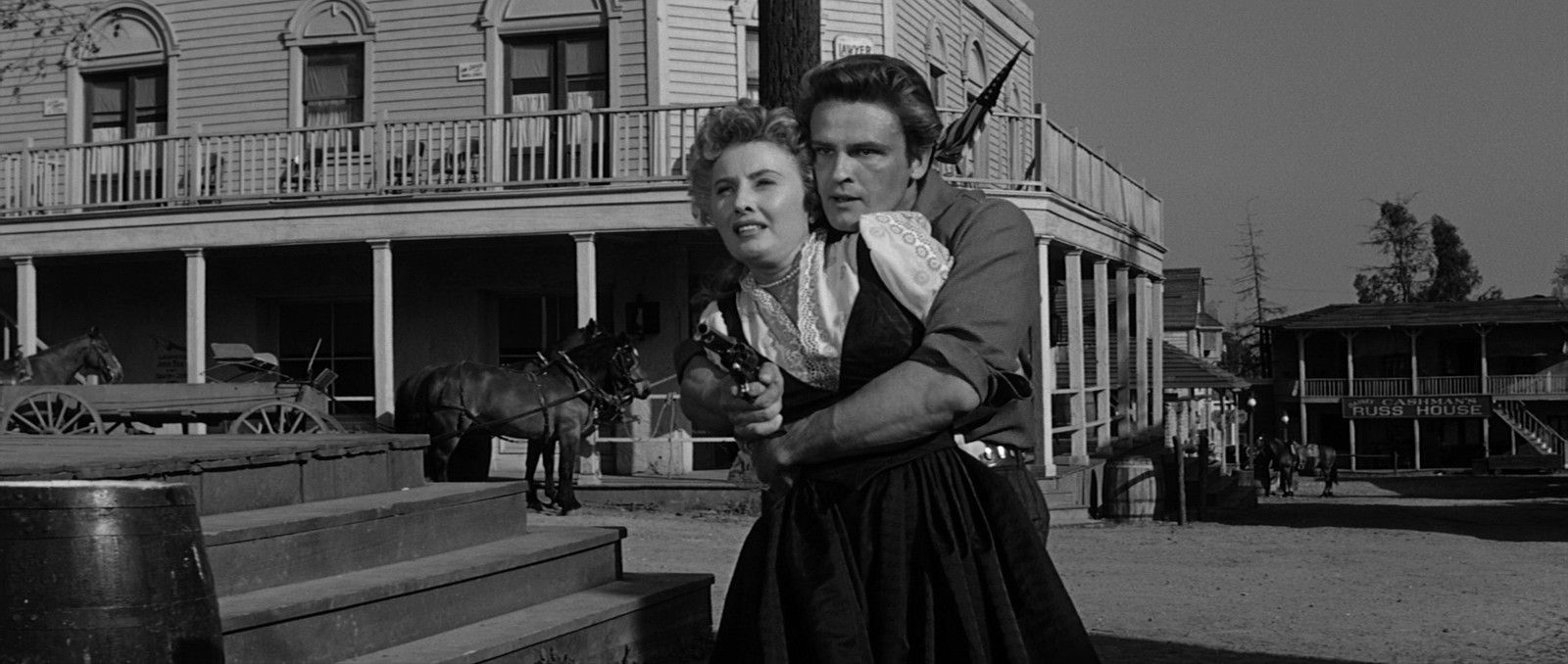 John Ericson as Brockie Drummond with Barbara Stanwyck as Jessica Drummond in  Forty Guns