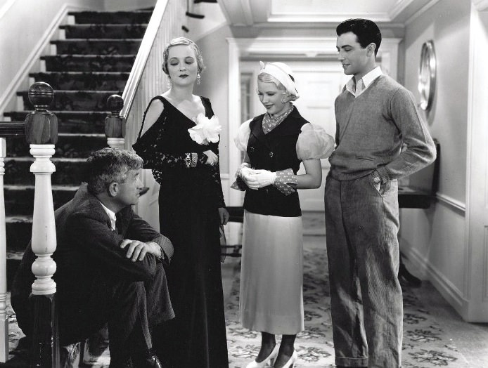 l. to r.: Will Rogers, Peggy Wood, Mary Carlisle and Robert Taylor in HANDY ANDY