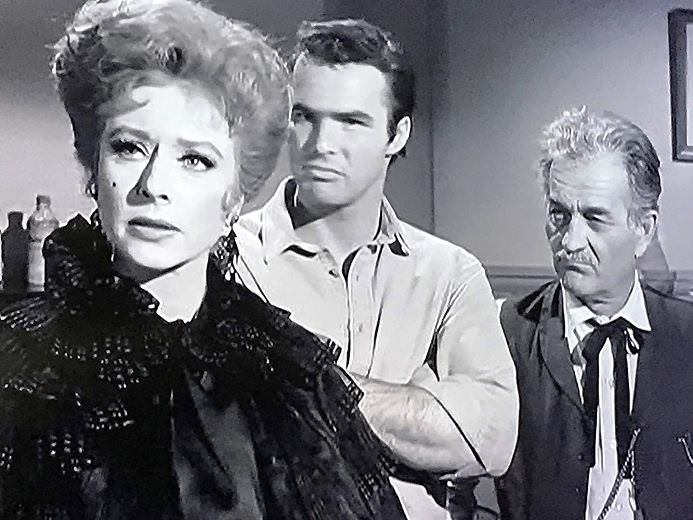 "Amanda Blake, Burt Reynolds, and Milburn Stone in ""Gunsmoke"""