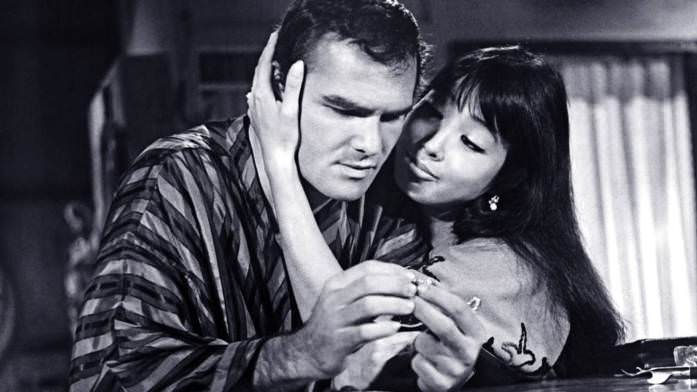Burt Reynolds and Miko Mayama in IMPASSE