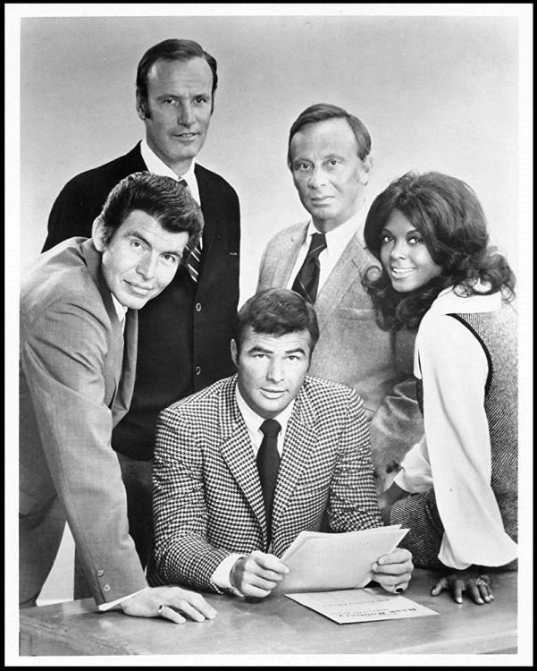 "The cast of ""Dan August"": (clockwise from top left) Richard Anderson, Norman Fell, Ena Hartman, Burt Reynolds, and Ned Romero."