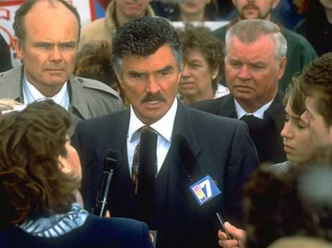 Burt Reynolds in CITIZEN RUTH (with Kurtwood Smith on his left)