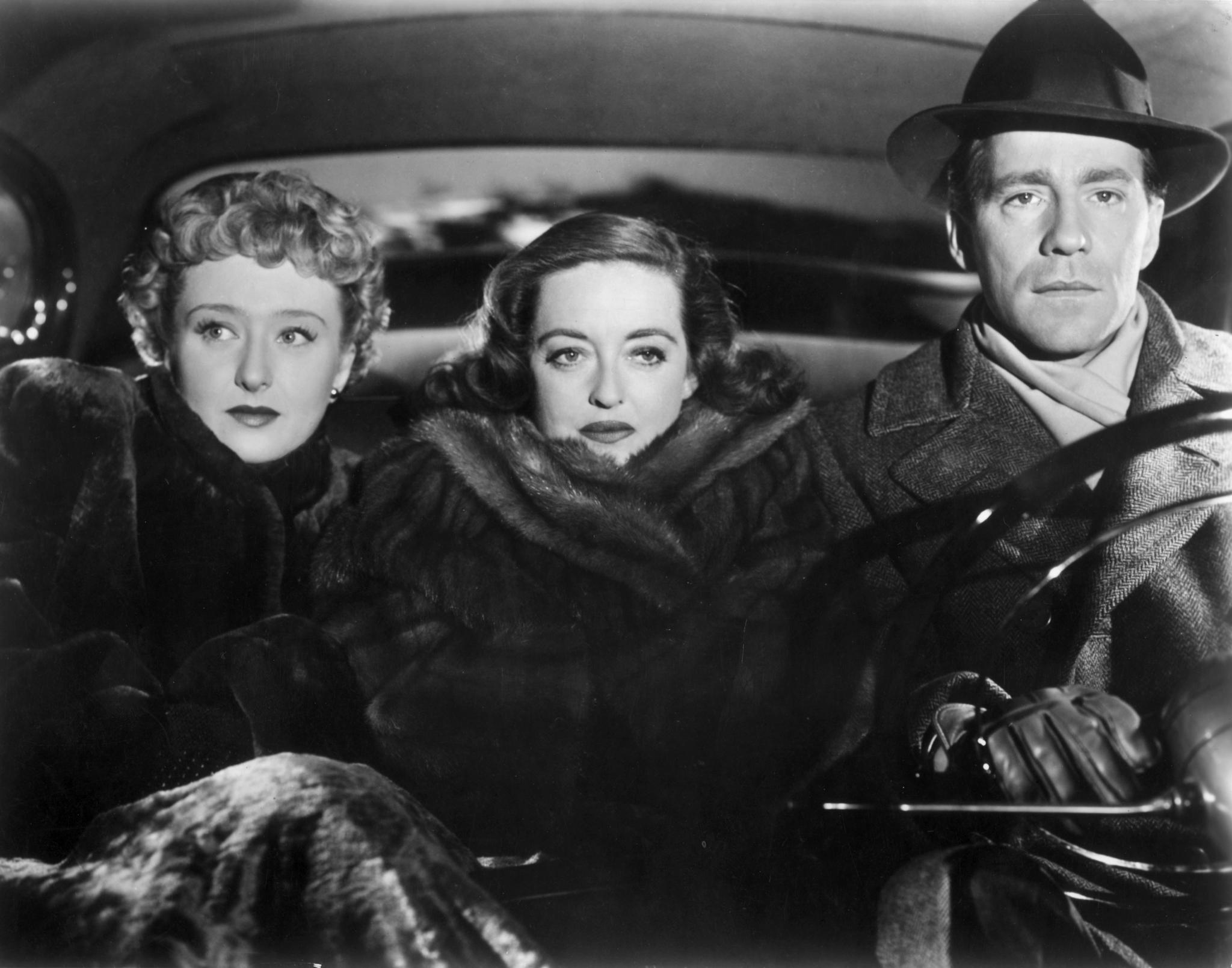 (From left) Celeste Holm, Bette Davis, Hugh Marlowe