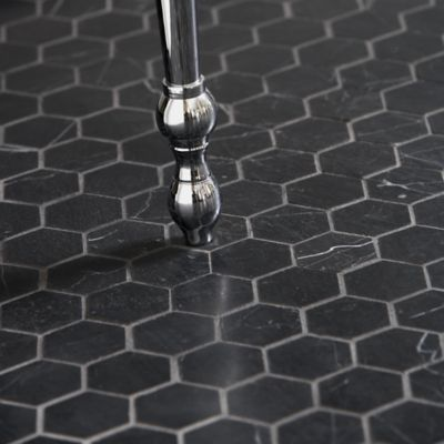 In second bathroom, we propose using black stone honed hexagon tiles. -
