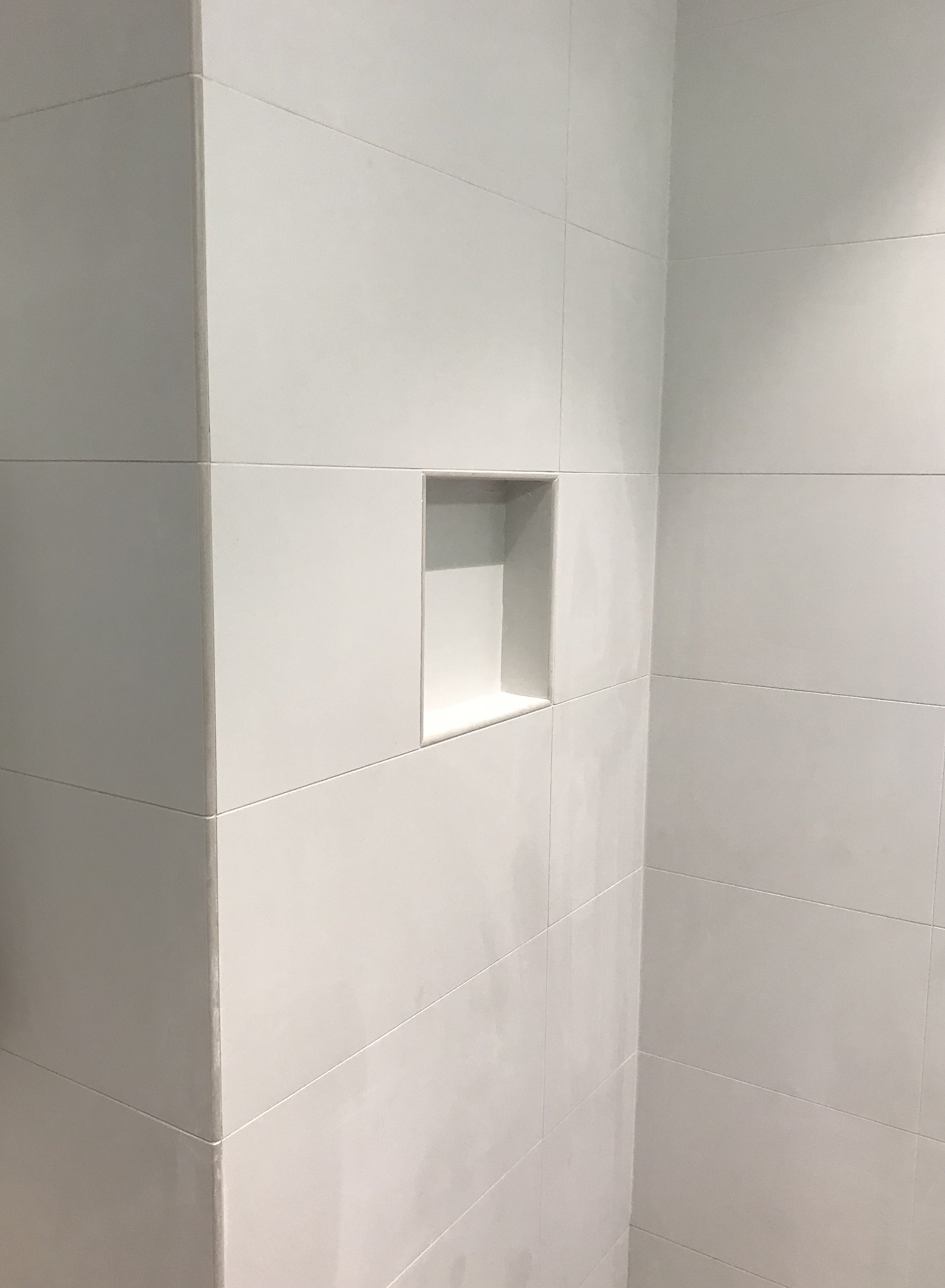 Another example of large white wall tiles. -