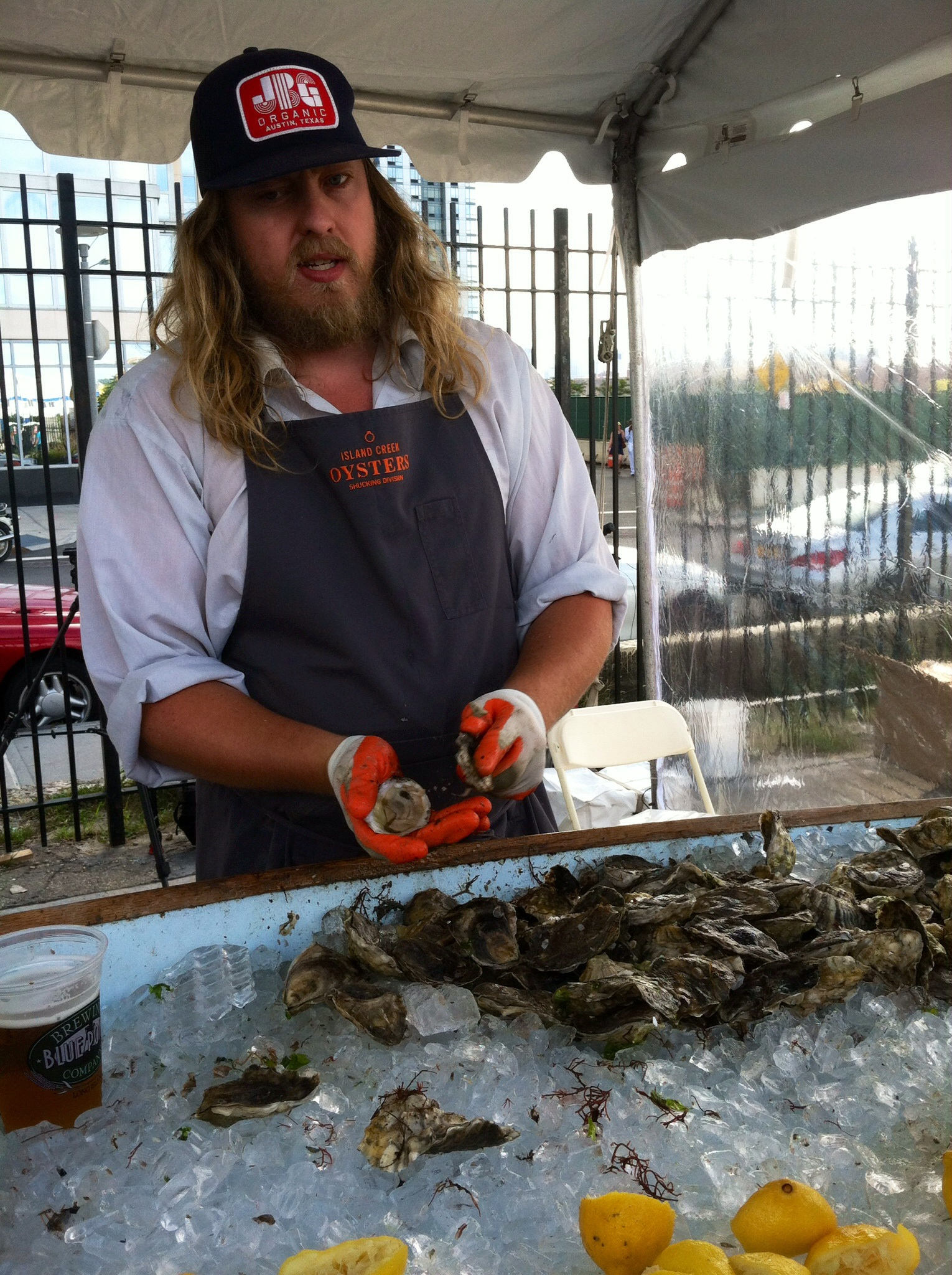 C.J. doing his shucking thang.  Photo by Shana Sokol, Shana Speaks Wine.
