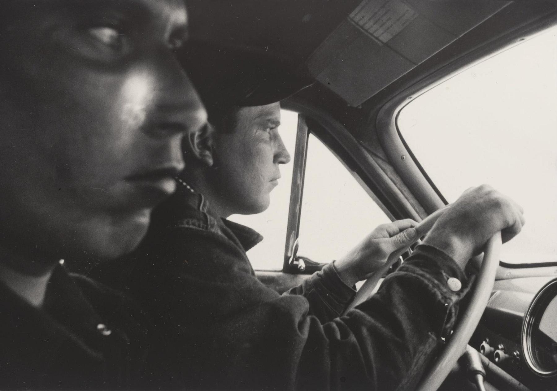 Hitchhikers leaving Blackfoot, Idaho towards Butte, Montana,  1956