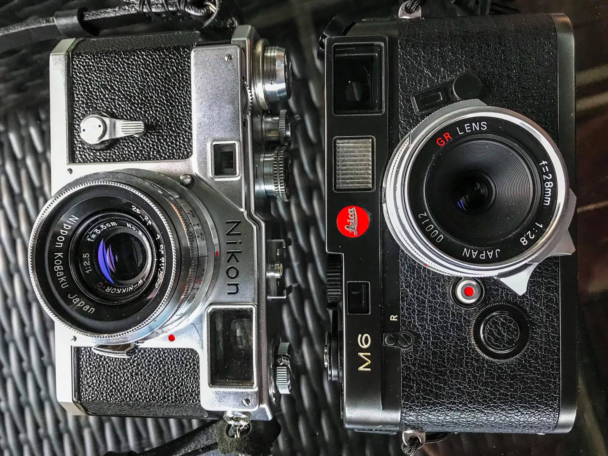 Nijon S3 next to the equally impressive Leica M6