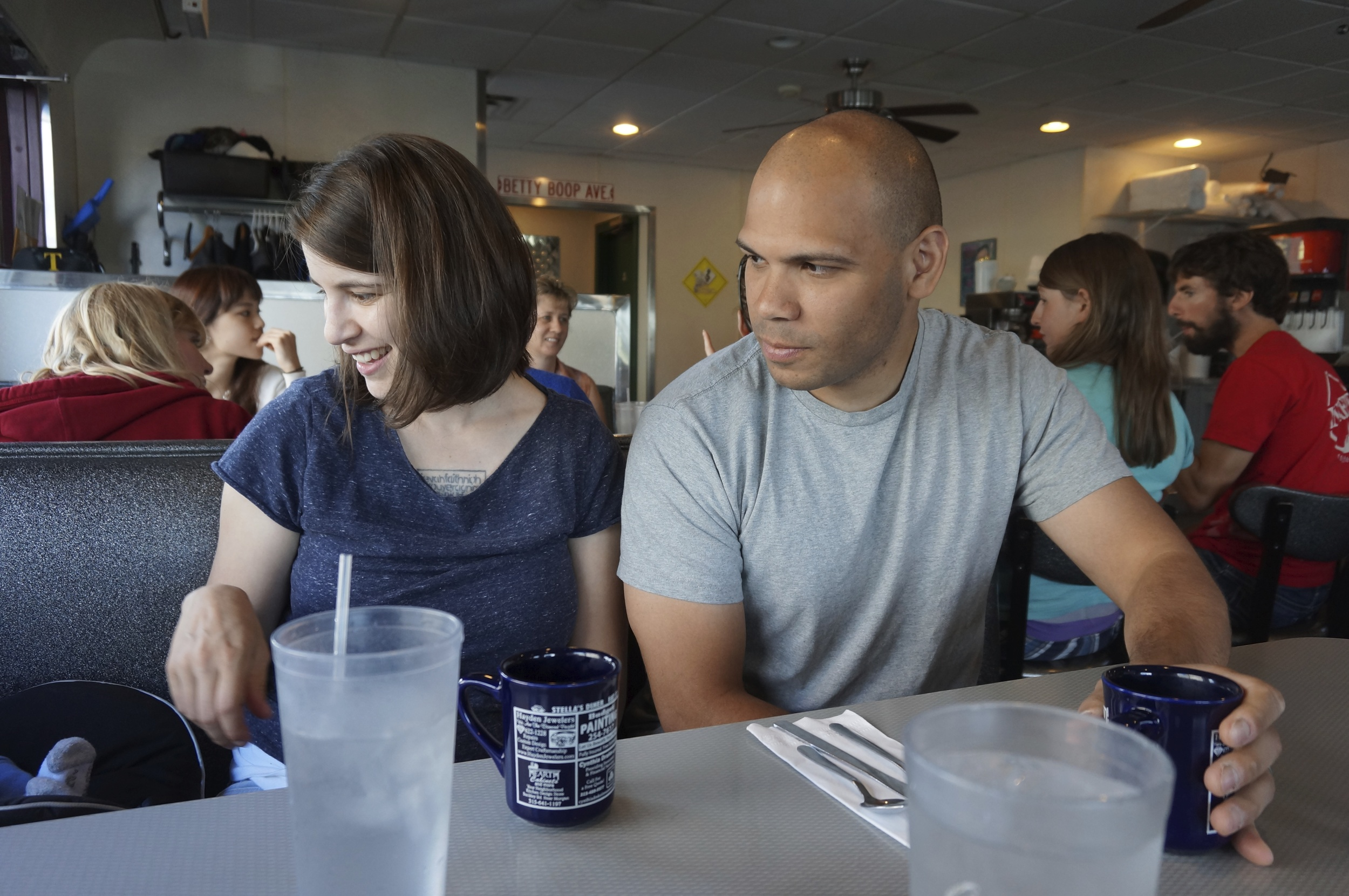 Rachelle & Josh keeping an eye on their three-monther at the diner.