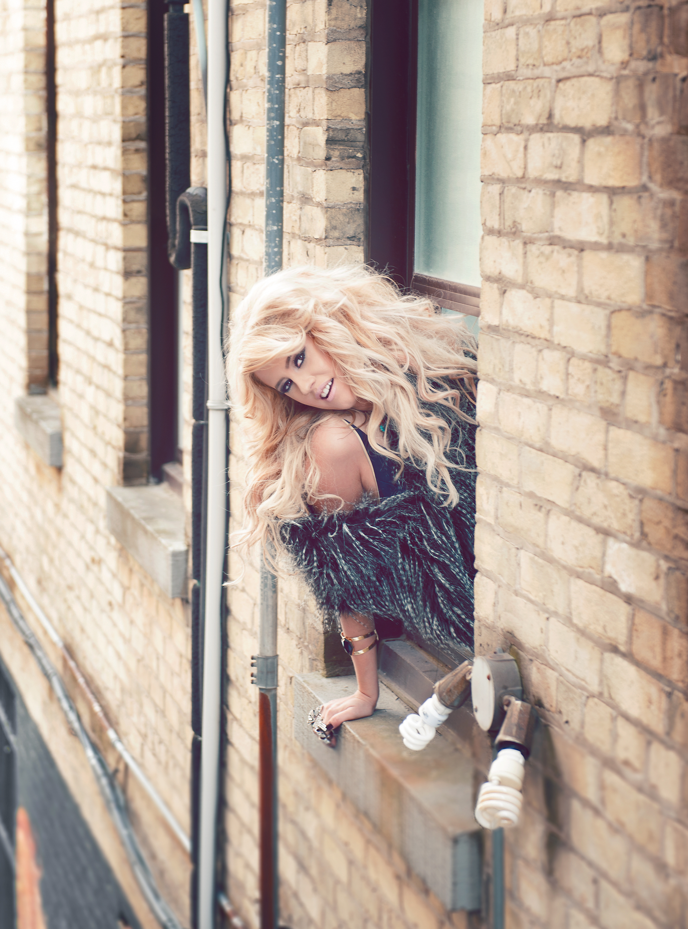 This was one of my favourite locations.. Here I had to brave the deep snow on the rooftop to get down to the landing on the fire escape, and shoot Cassidy as she leaned out the window of the loft for a fashion/glamour kind of look.