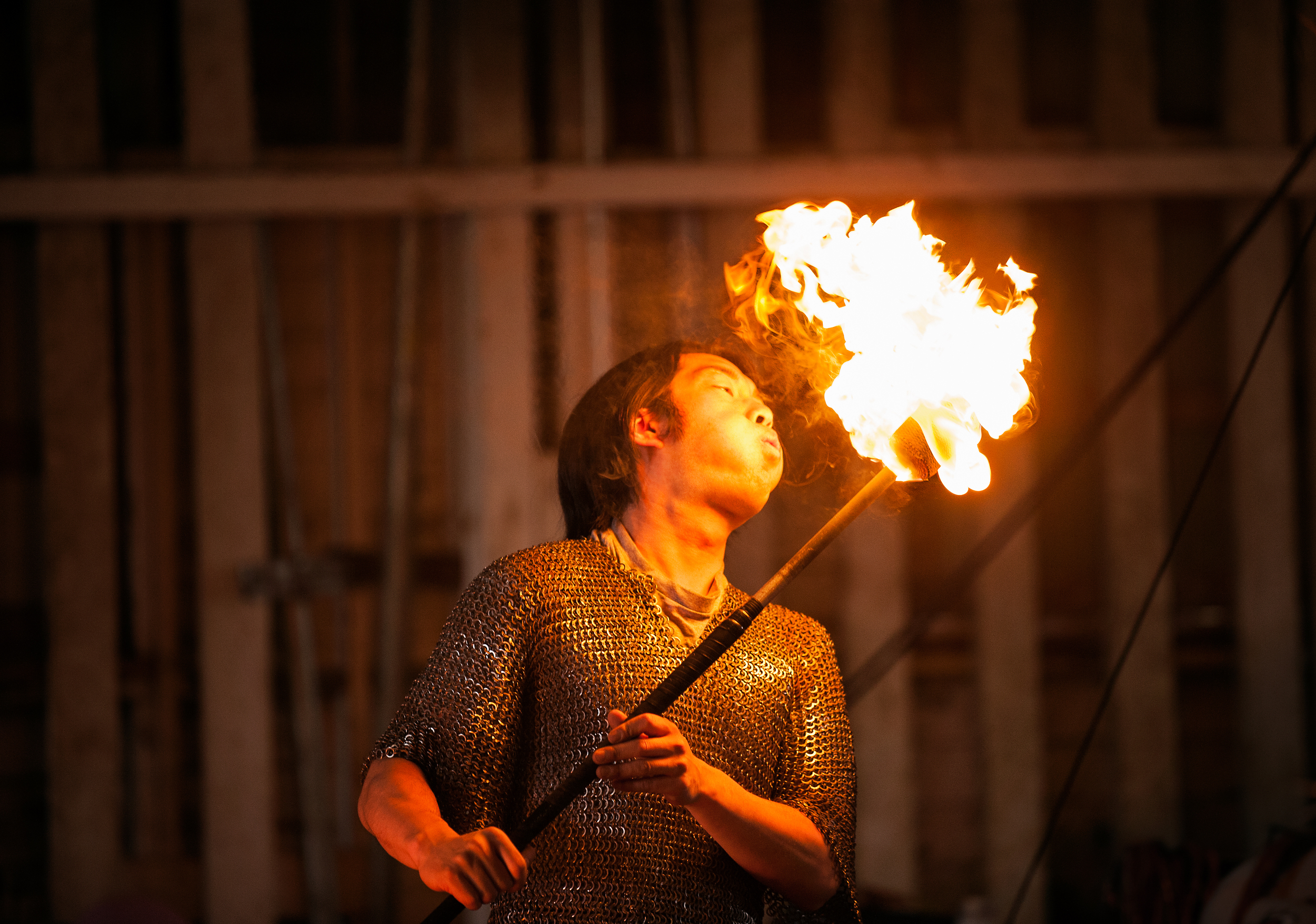 © Kevin Vyse Photography  All rights reserved 2014   Fire Blower getting a flame to burst off the end of the baton.