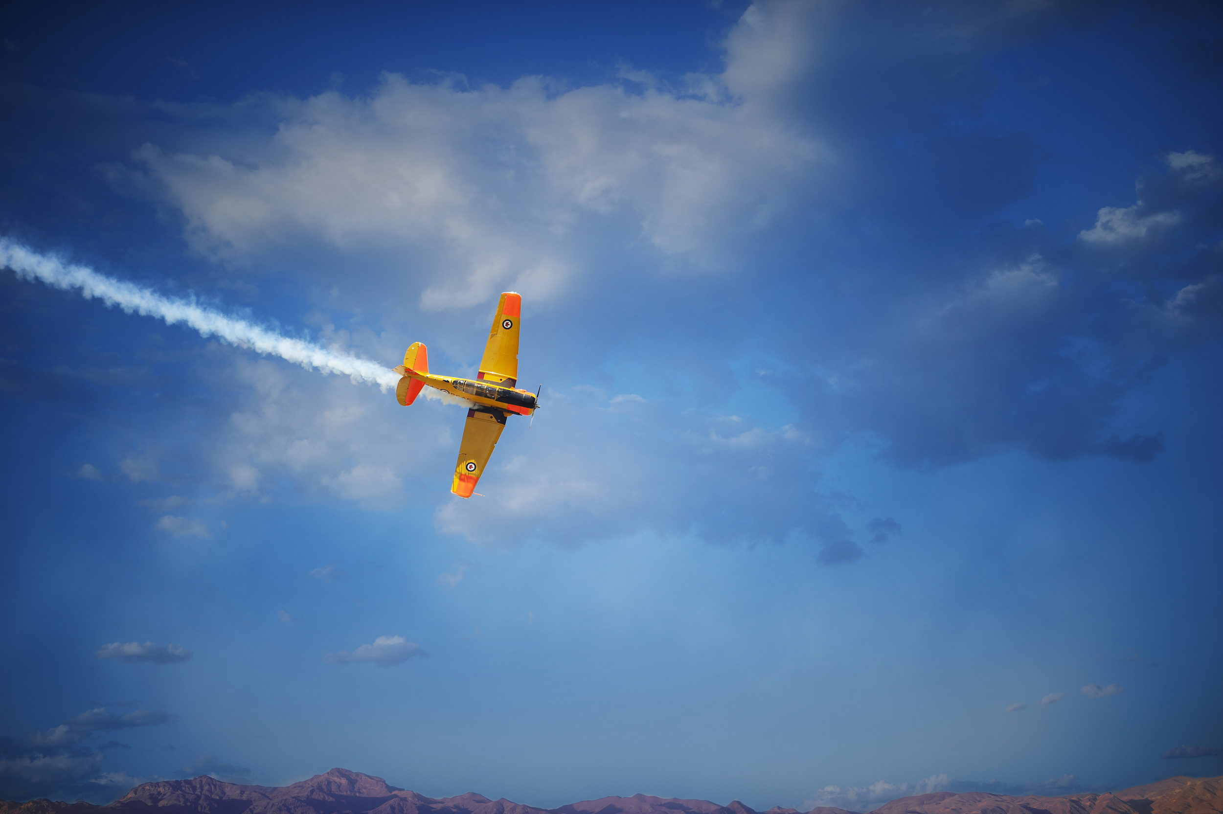 Rick Volker, Banking hard in front of the crowd as he gains some momentum and air speed to perform some more amazing aerobatics.