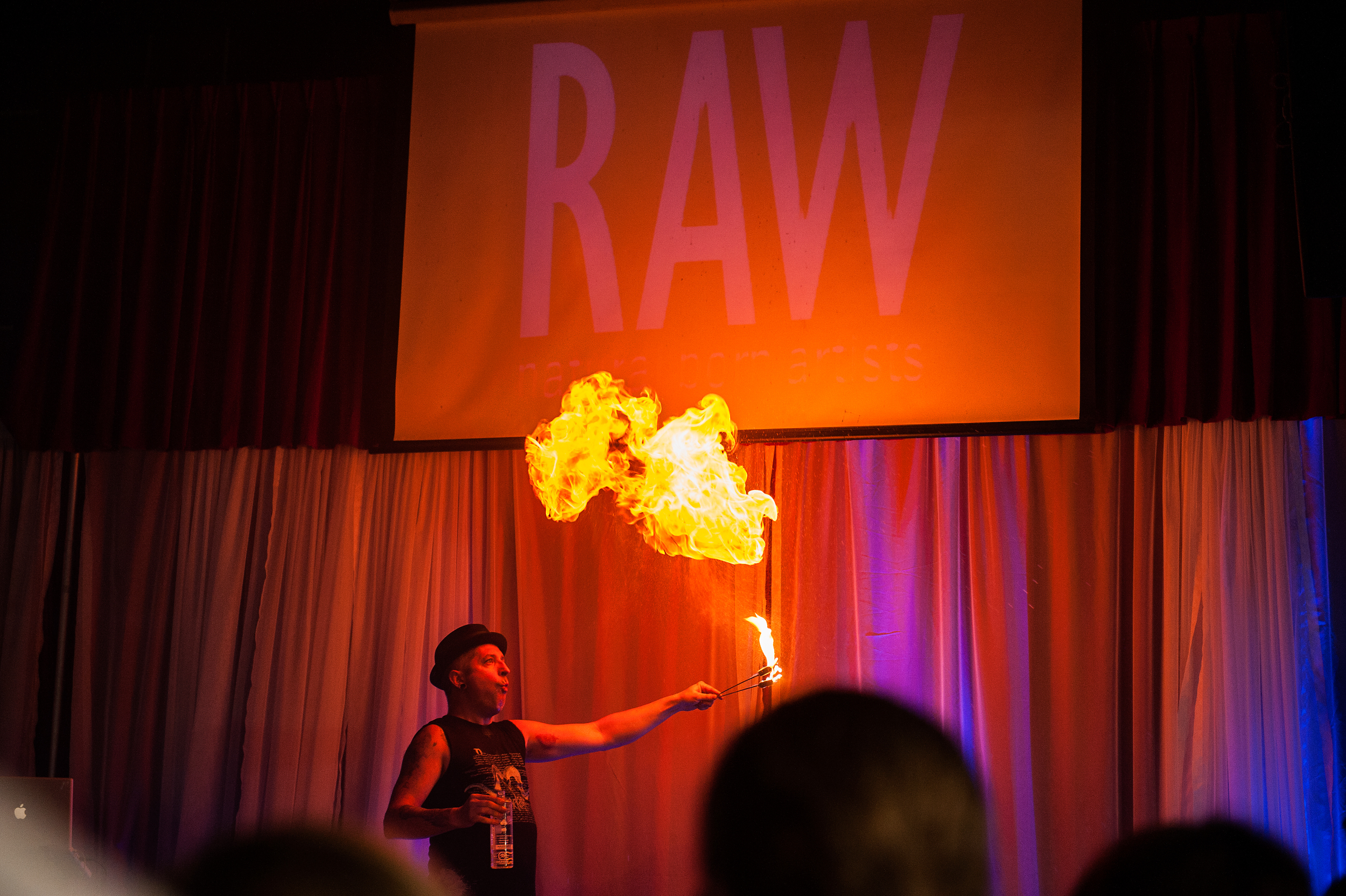 Fenyx Fyre on stage at RAW blowing out a huge fire ball! what an amazing act.