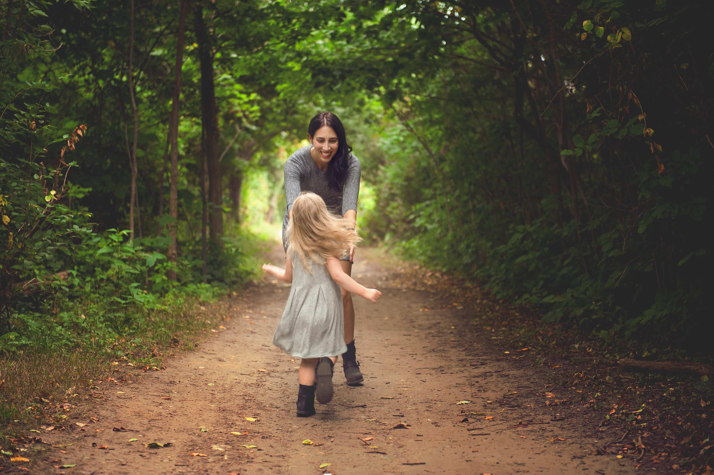 A another image of pyper running into her moms arms after she was getting tired of walking and just wanting to go home.