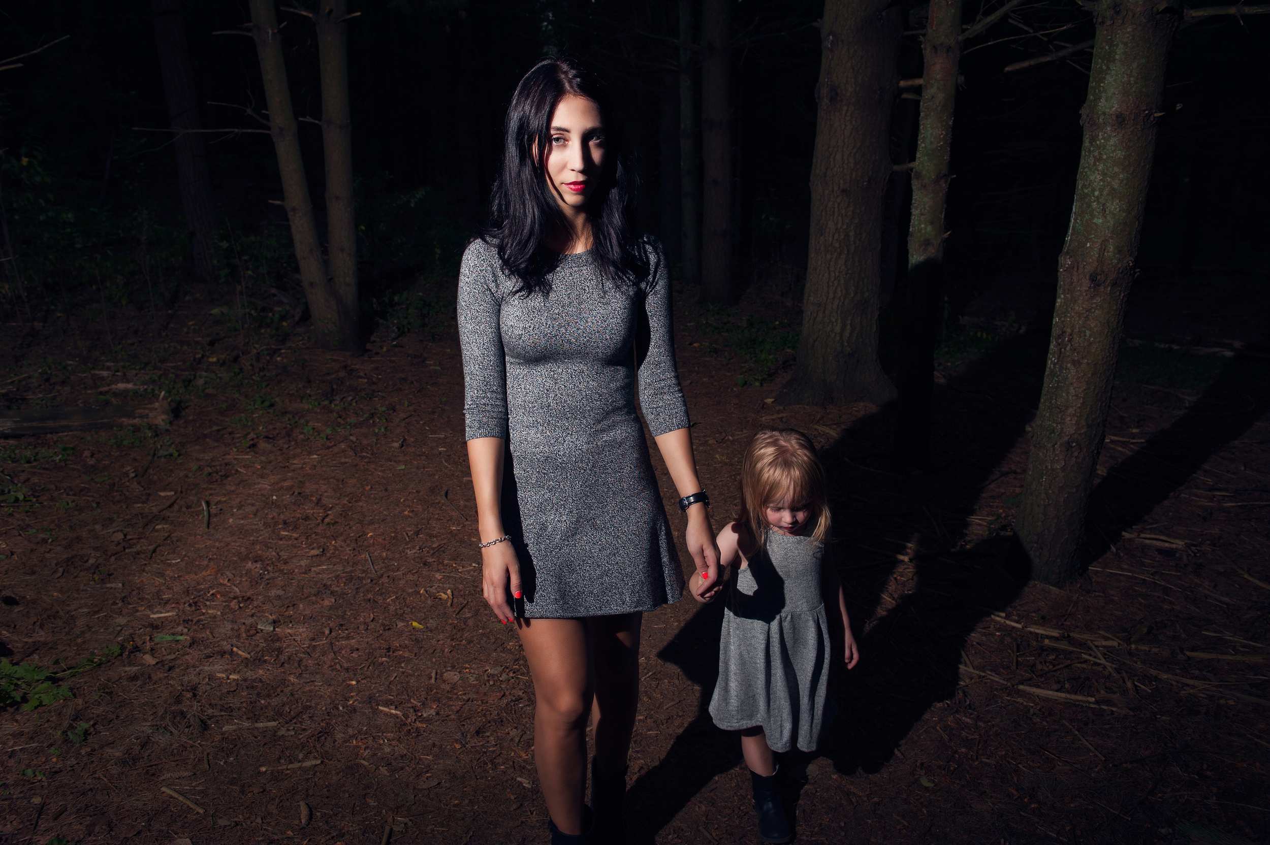 "These trails can get pretty dark and seem a little creepy. Pyper thought there were packs of wolves in the forest and kept yelling out ""pack of wolves"". We decided to use this to our advantage and do a creepy, dark woods image using hard light to cast shadows amongst the trees."