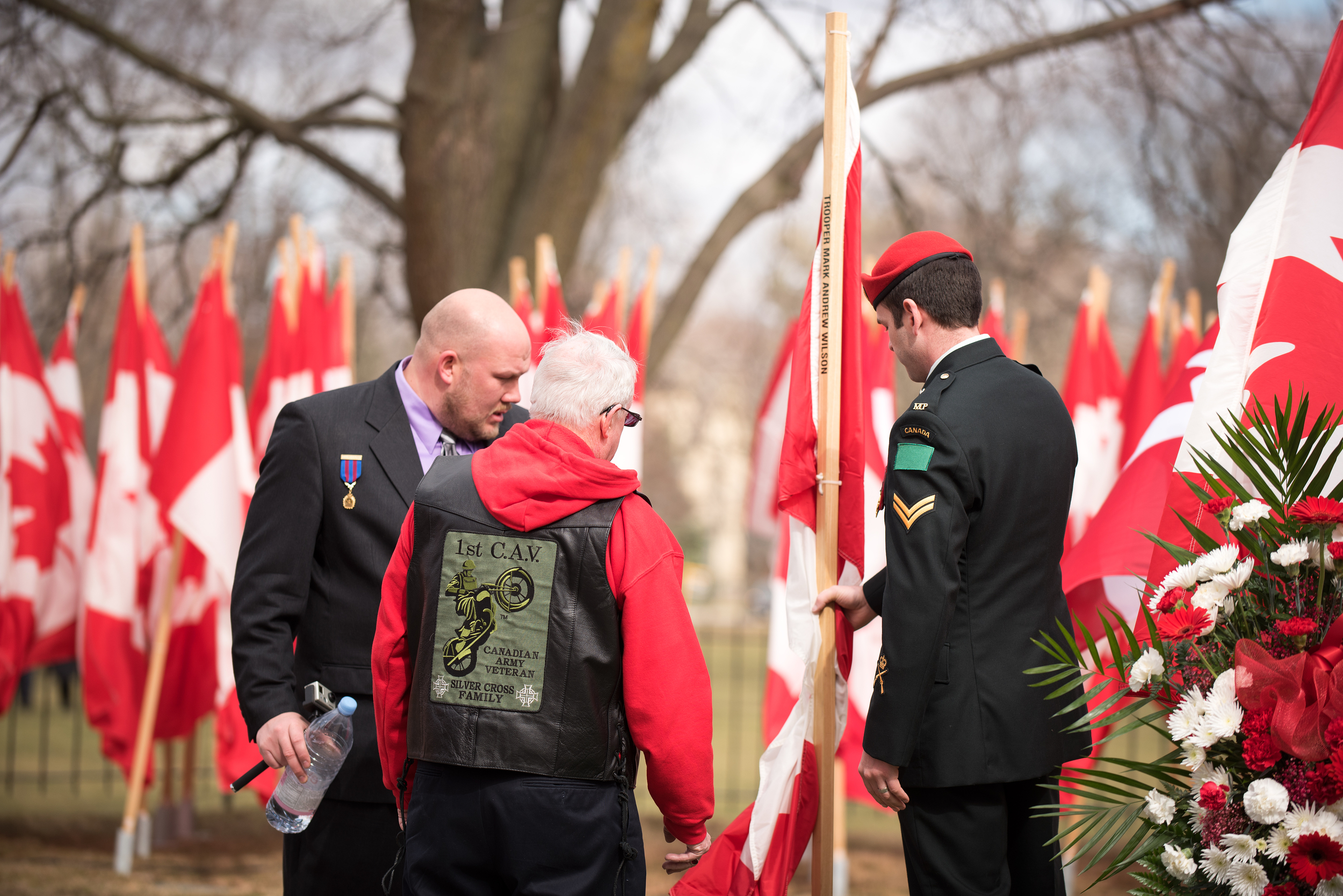 Jeremy and Kevin show a father of one of the fallen, his sons flag which was placed directly behind the Battle Cross.