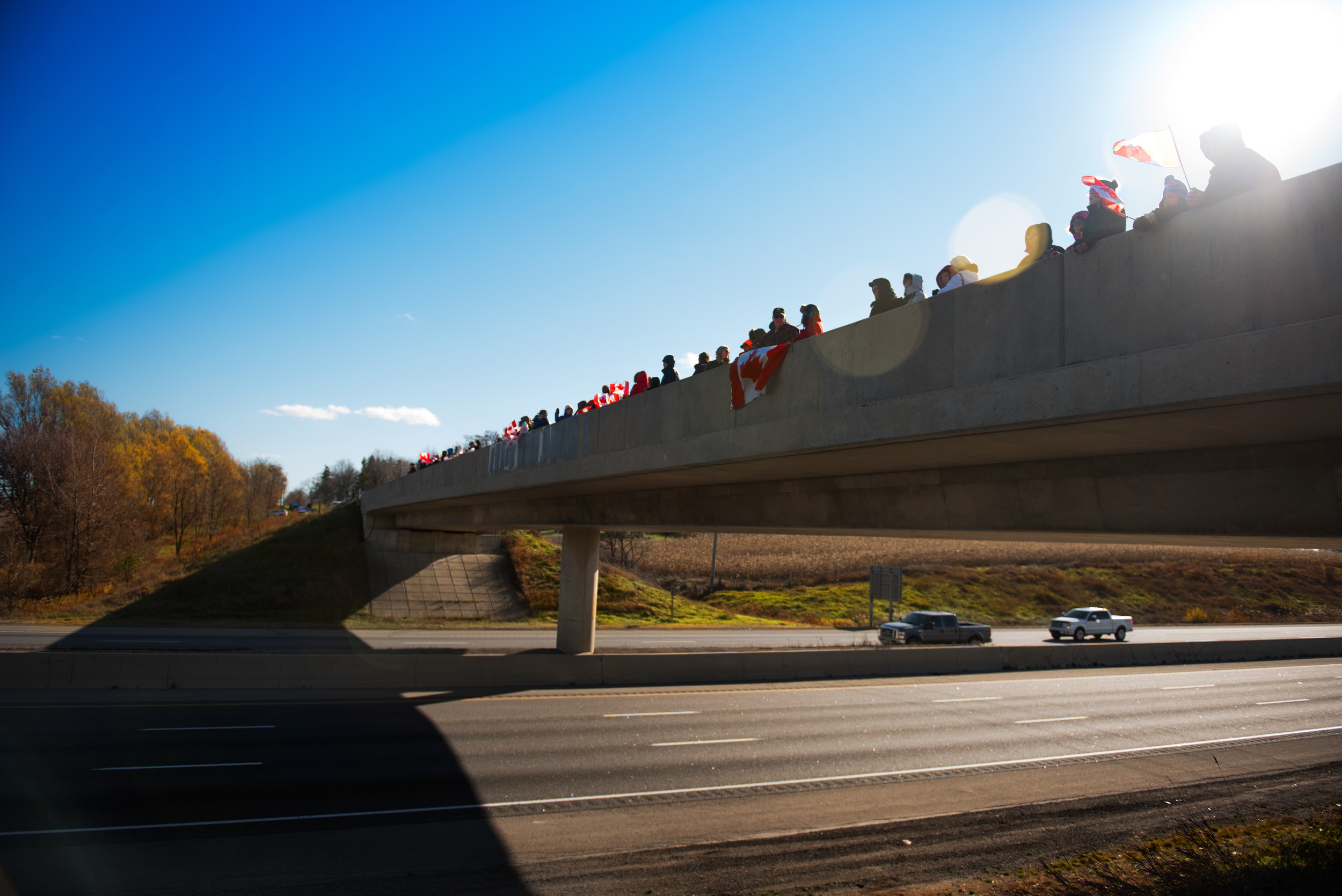 The Crowd Gathers to pay respects to John Gallagher as he passes in Woodstock Ontario at the Dodge Line bridge. A lot more people showed up, including Beachville Fire.. this was about 2 hours before he arrived.