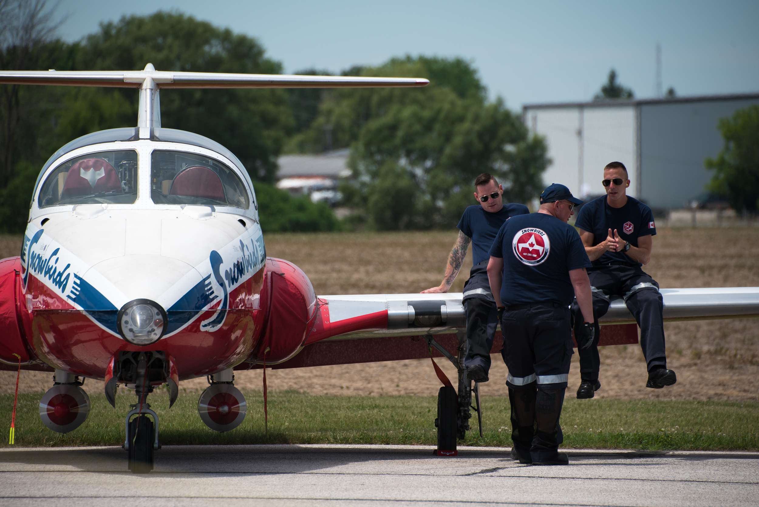 Snowbirds Ground Crew relaxing - Print.jpg