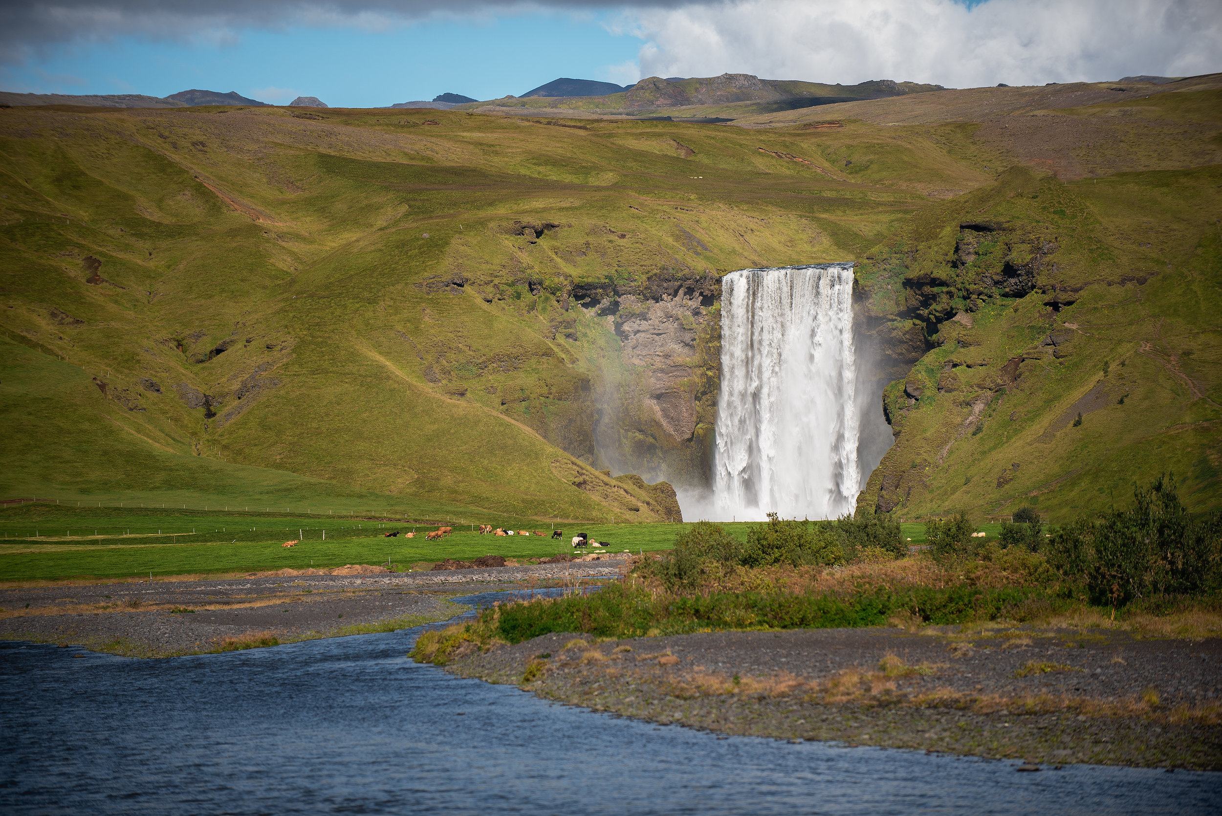 Skogafoss - the water giant from far... spent my first night in the camper van here at the base of this monster as it sang me to sleep.