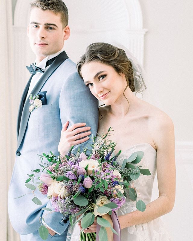 Still obsessing over this lovely lavender editorial from last spring. ⠀⠀⠀⠀⠀⠀⠀⠀⠀ Venue: @thecommons1854 | Photographer: @jessicakfeiden | Hair+Makeup: @_jennyluu | Florals: @karlacassidydesigns | Calligraphy: @mcbrideink| Stationery: @jkfdesignco | Cake + Confections: @mayflourconfections | Rentals: @kadeemarentals | Bridal Gown + Bridesmaid Dress: @bellabridalshoppe | Custom Suit: @hiveandcolony | Shoes: @bellabelleshoes