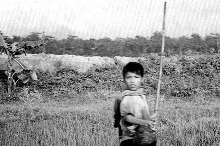 Shepherd boy on the road back to Hanoi