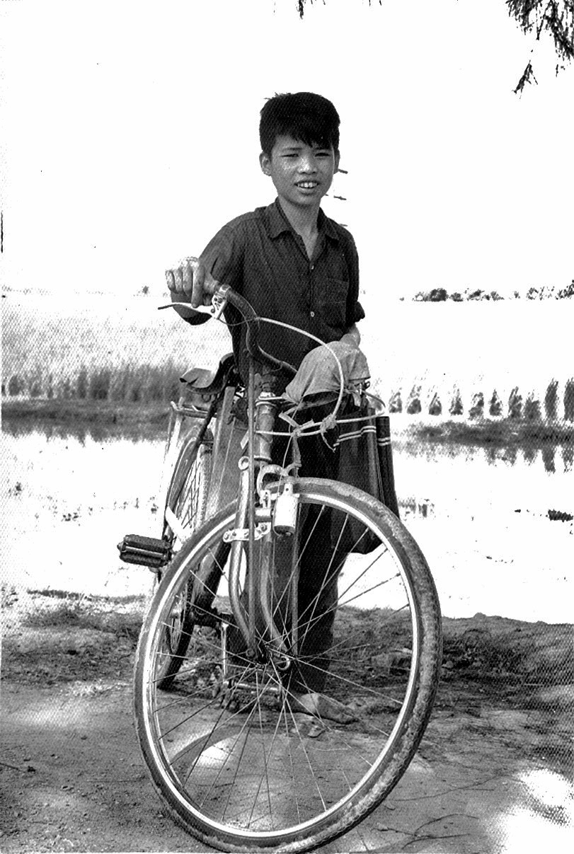 Cyclist proudly displaying his bicycle