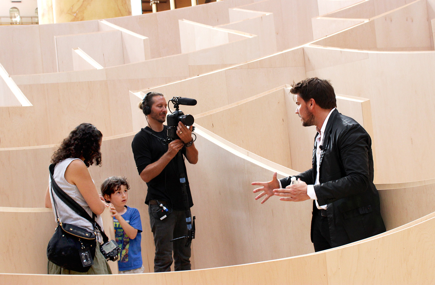 Bjarke Ingels gives a young visitor a simple explanation of how the maze was built.