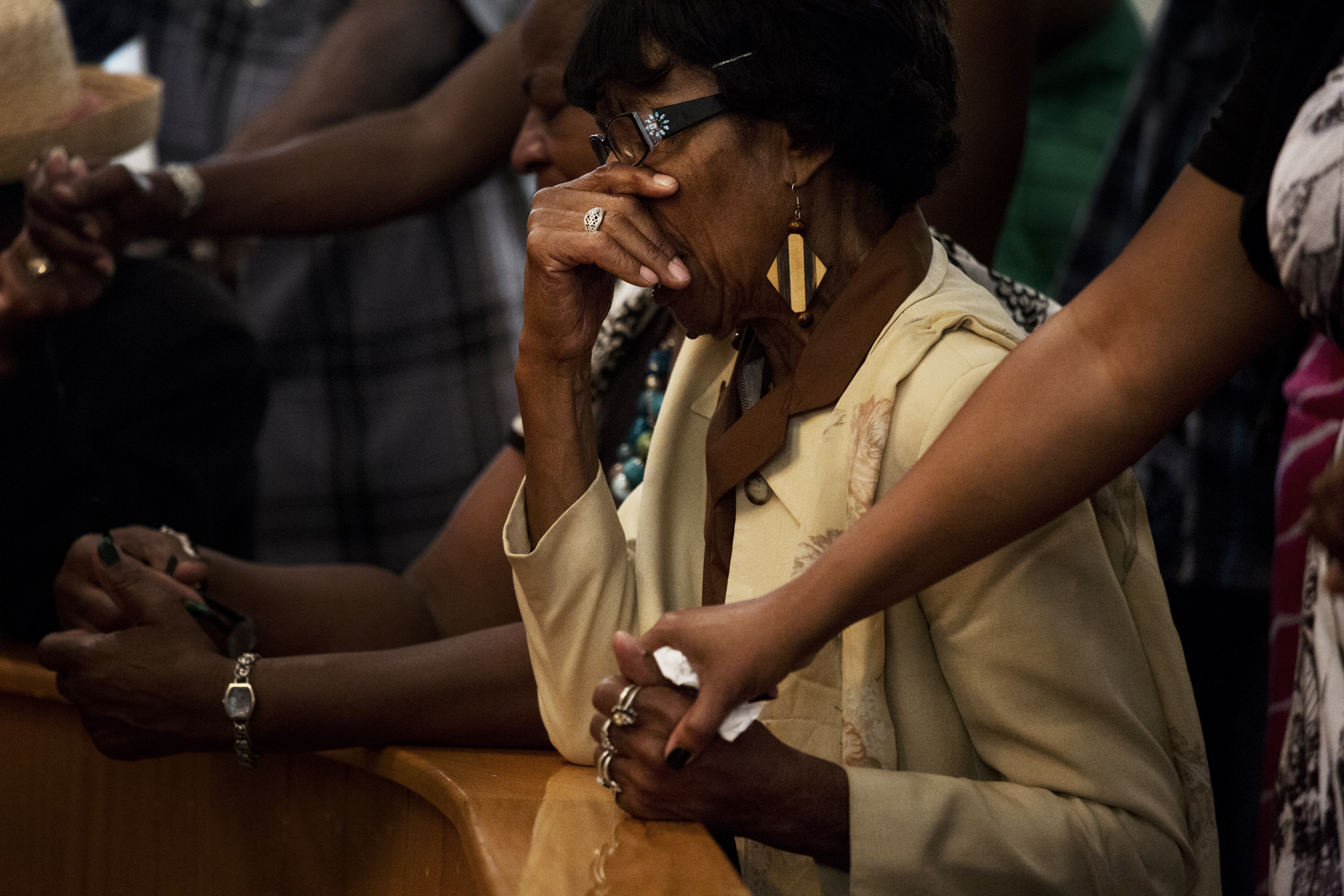 Members of the First AME congregation gather at the alter after Reverend Margaret Redmond's sermon concerning the George Zimmerman trial Sunday, July 14 2013.