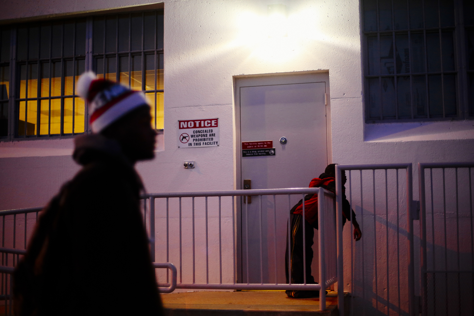 Lorenzo Estes, left, and Noah Cooley wait for Glen ward at the back of the Armory in Columbia, Mo, where they have drum line practice.