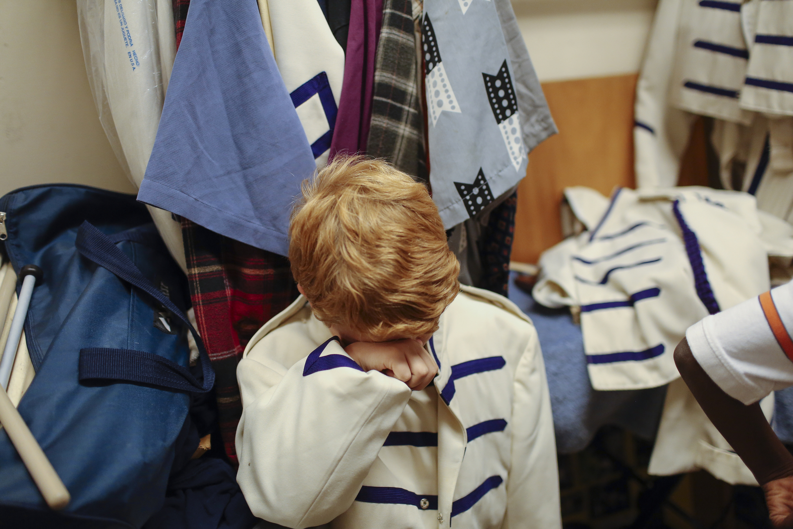 Axel Littlepage-Holmes wipes his eyes while trying on uniforms for the Columbia City-Wide drum line. Axel is the smallest and youngest on the drum line, and Ward didn't have pants that matched the uniform coat.