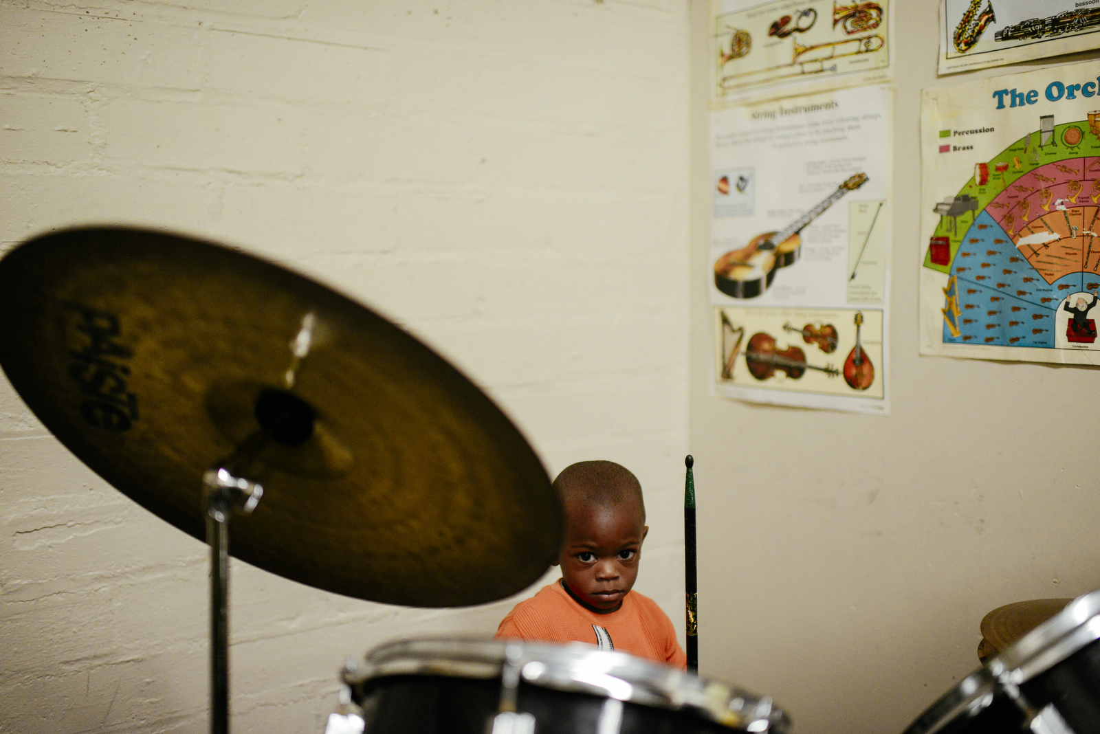Jai'Keem Robinson-Hill, 2, plays the drumset during private lessons with Ward at the Armory in Columbia, Mo. The drum lessons Ward offers are at no cost to parents.