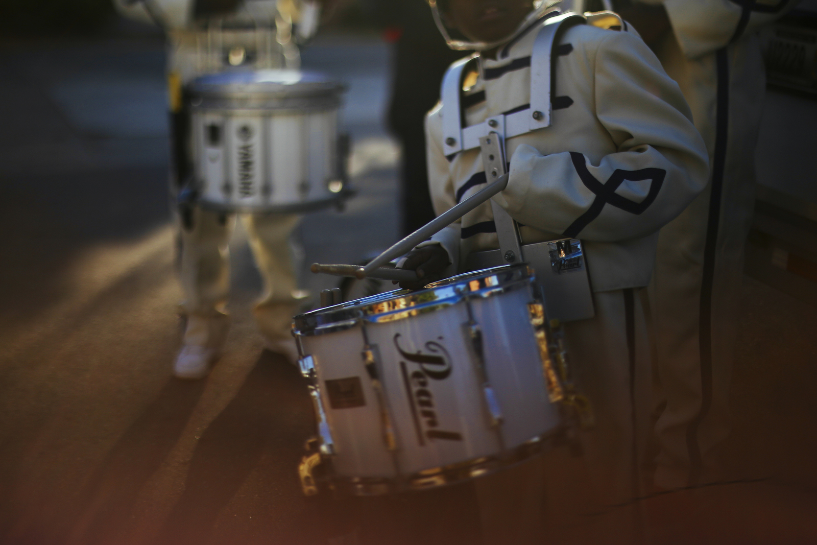 Noah Cooley's sleeves on his uniform come unrolled while practicing rolls with the drum line.