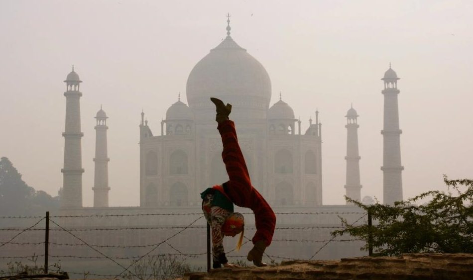 circus 13 Contortion in India with the Taj Mahal.jpg