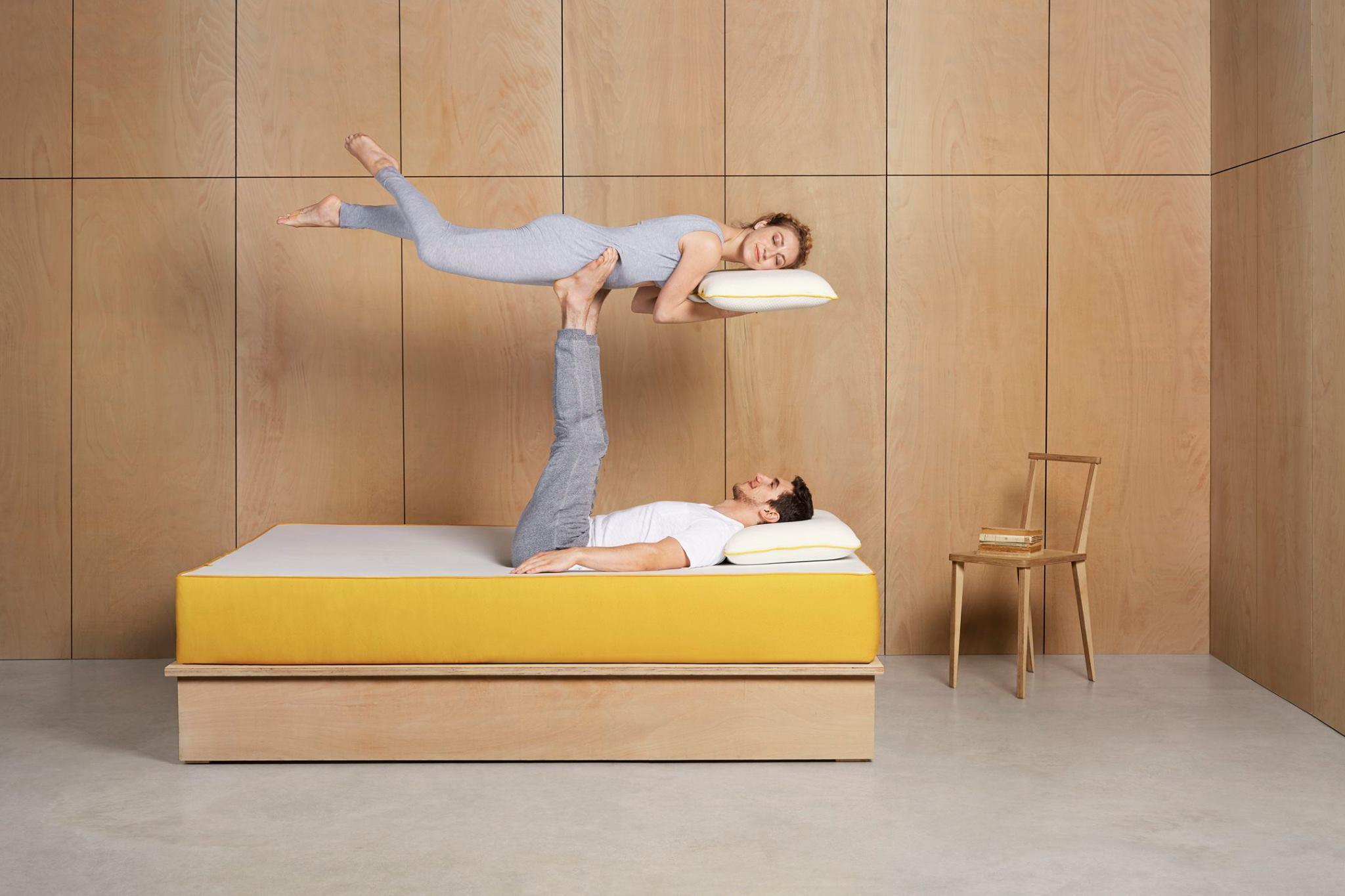 Eve Mattress sleeping in bird with pillow.jpg