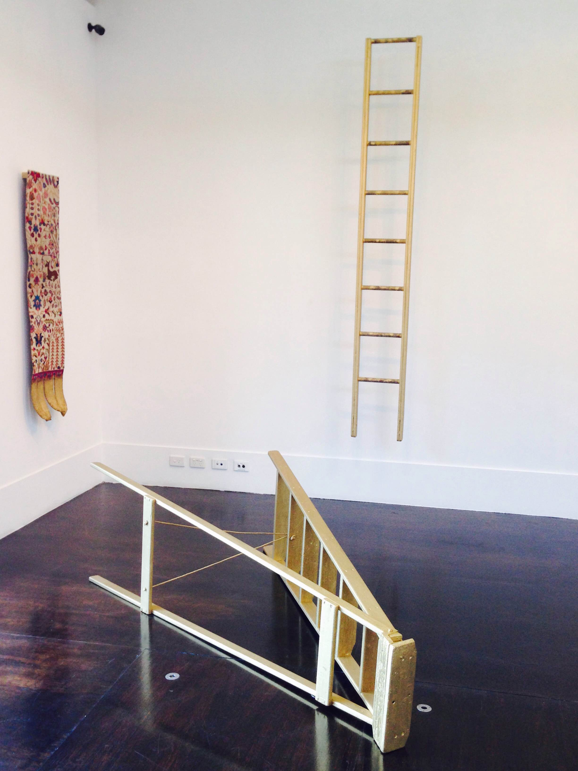 Image:  Queer Bloodlines (After Orjis) , 2015, timber ladders, altered Persian carpet, gold acrylic, rose water, dimensions variable.